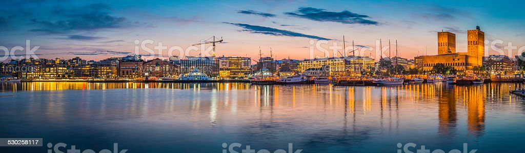 Oslo waterfront illuminated dusk City Hall harbour Aker Brygge Norway stock photo
