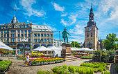 Oslo woman walking through flower market in square Stortovet Norway