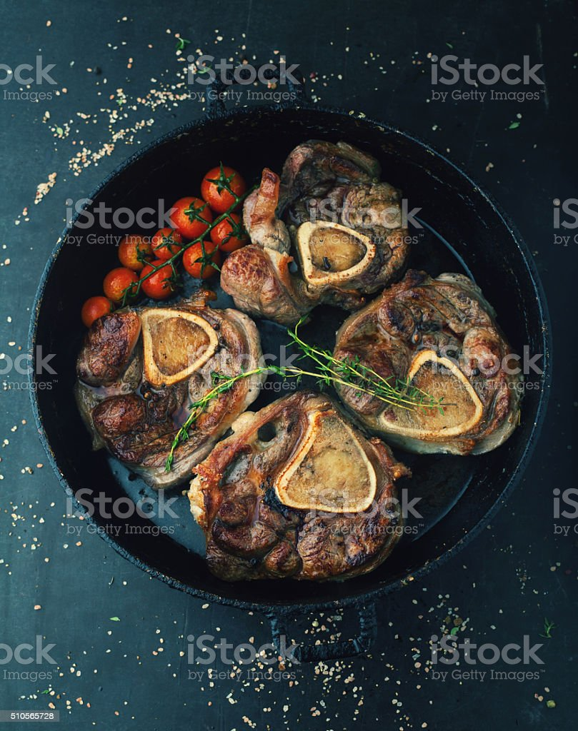 Ossobuco roasted in white wine and thyme stock photo