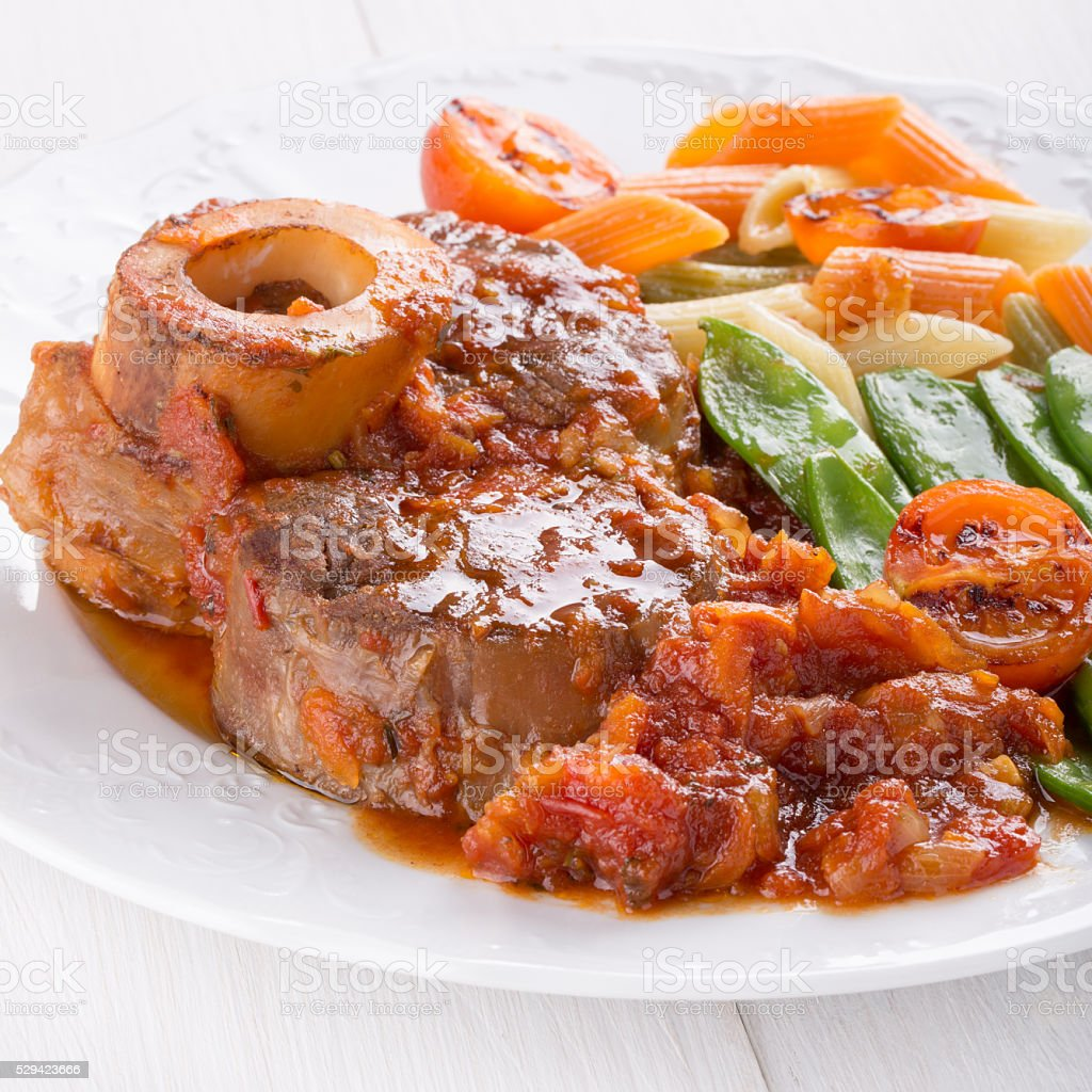 Ossobuco.Cross-cut veal shanks braised with vegetables. stock photo