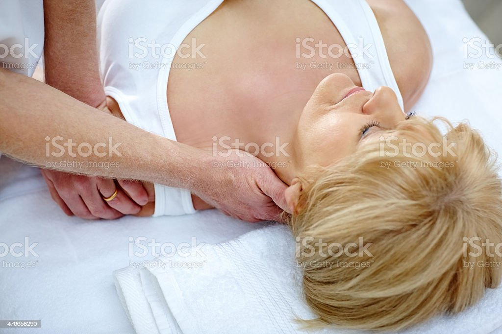 Osteopath treating female patient with neck problem stock photo