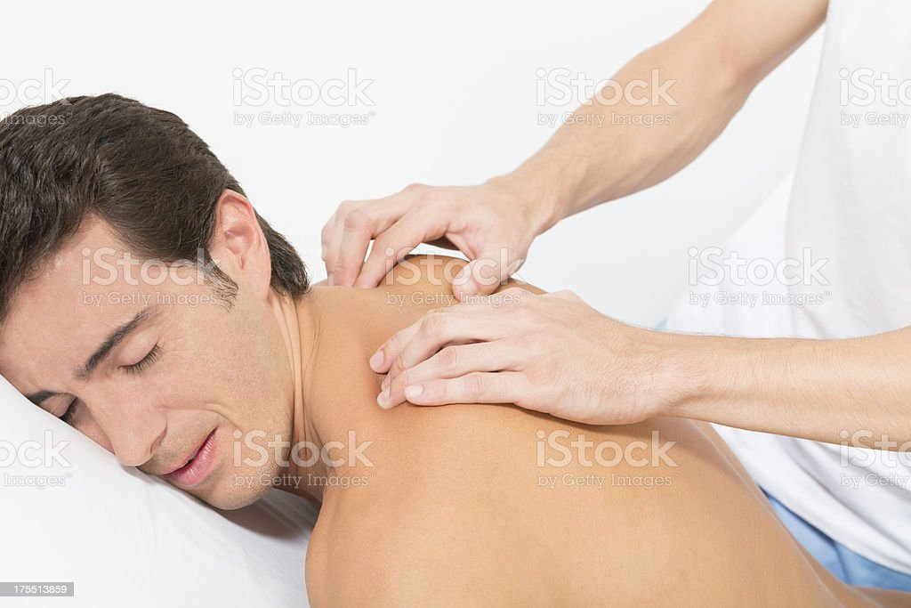 osteopath treating patient royalty-free stock photo