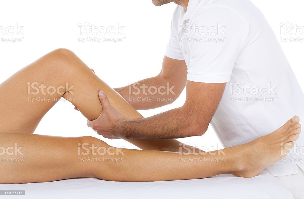 osteopathy treatment female leg stock photo