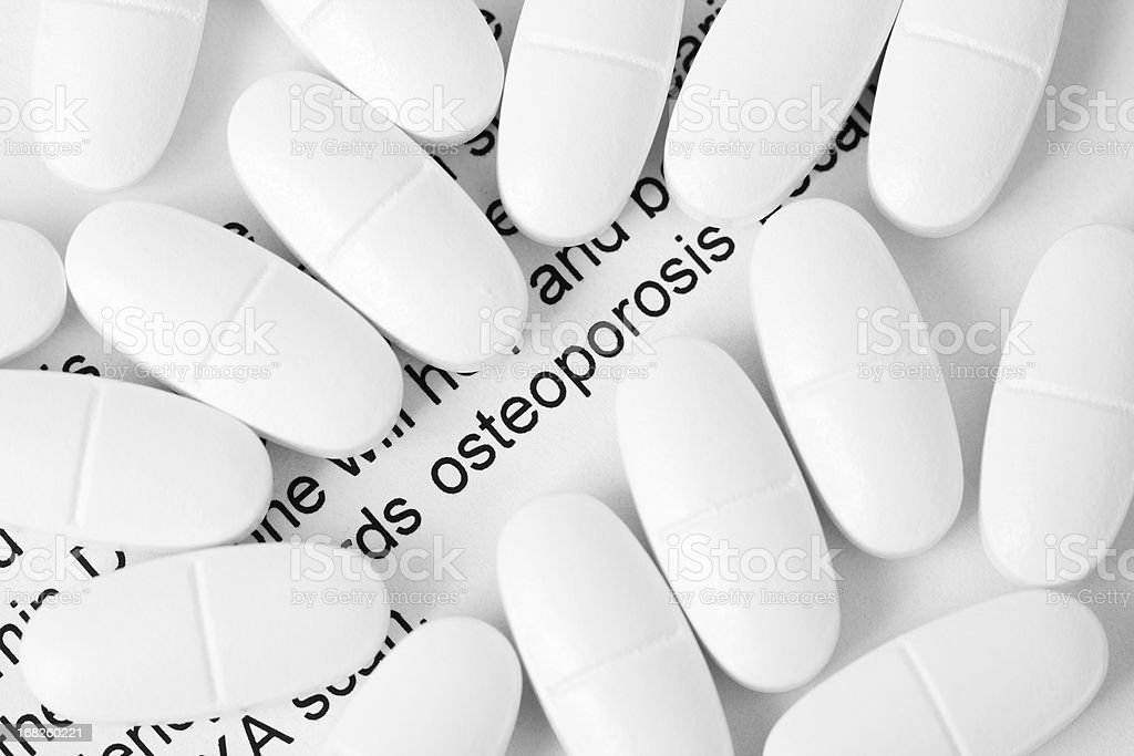 Osteoporosis and Calcium Pills stock photo