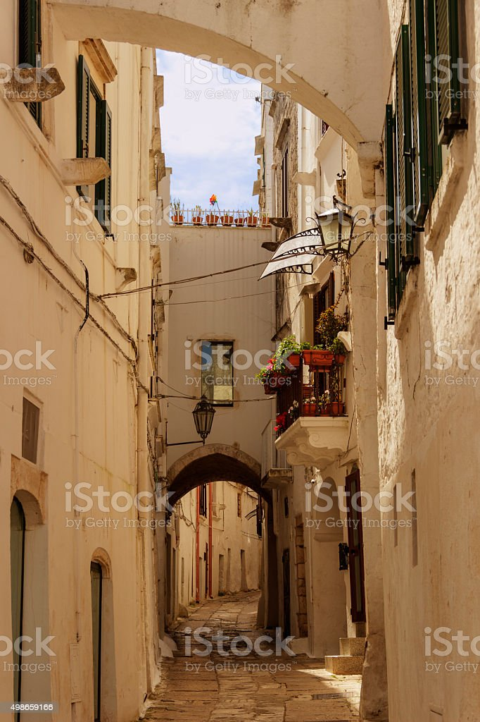 Ostuni:stroll through the narrow alleys where white houses are dotted.-ITALY(Apulia)- stock photo