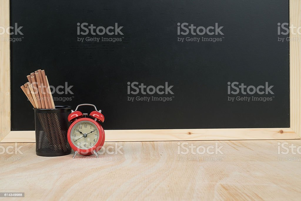 other equipment  and red clock on  desk stock photo