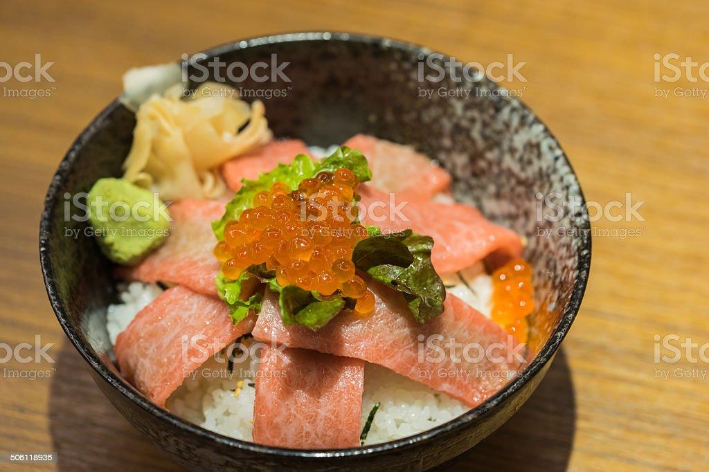 Otoro sashimi and salmon eggs on top of Japanese rice stock photo