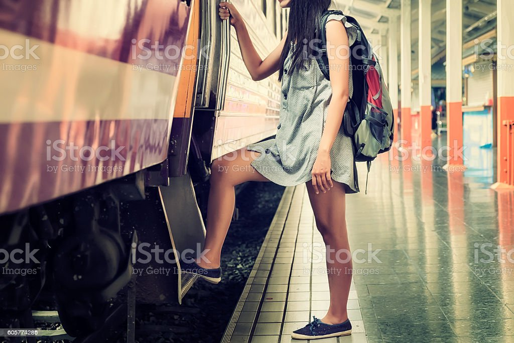 oung female traveler with backpack stock photo