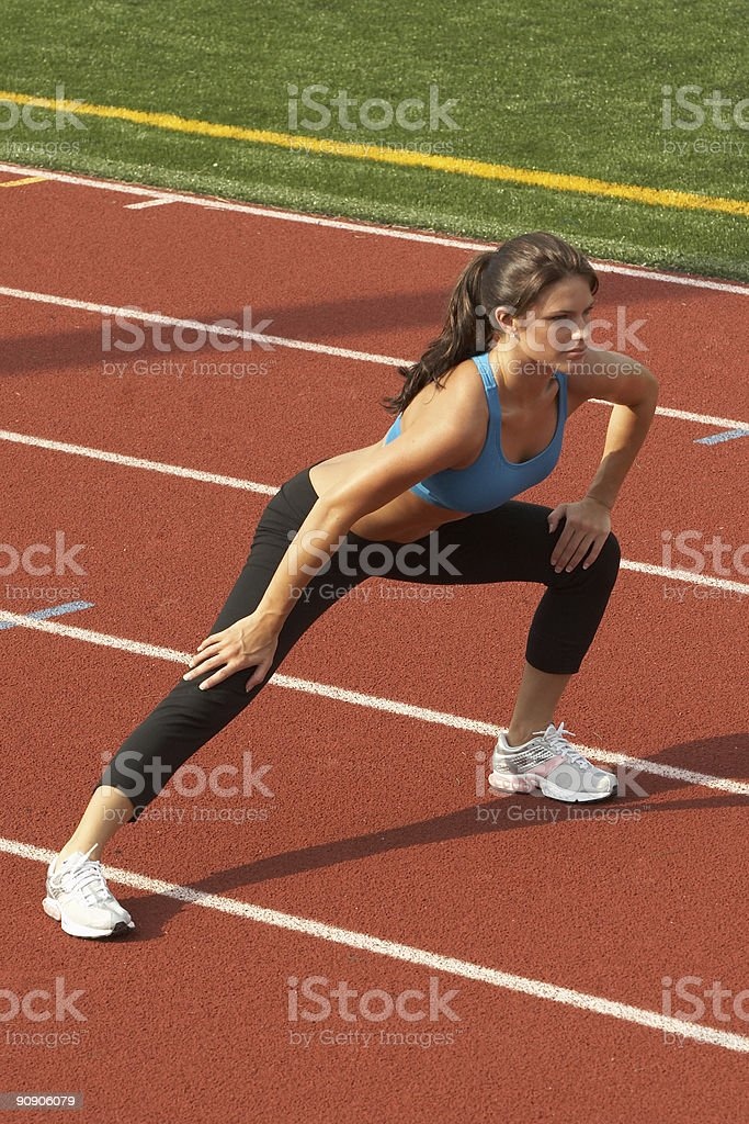 oung Woman in Sports Bra Doing Leg Lunge royalty-free stock photo