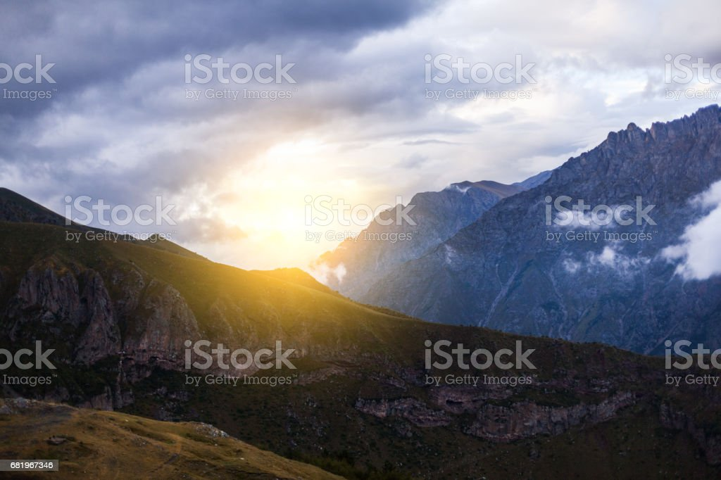 ountain panoramic view on a evening. Beautiful evening mountain landscape under bright sunset. Georgia Kazbegi stock photo