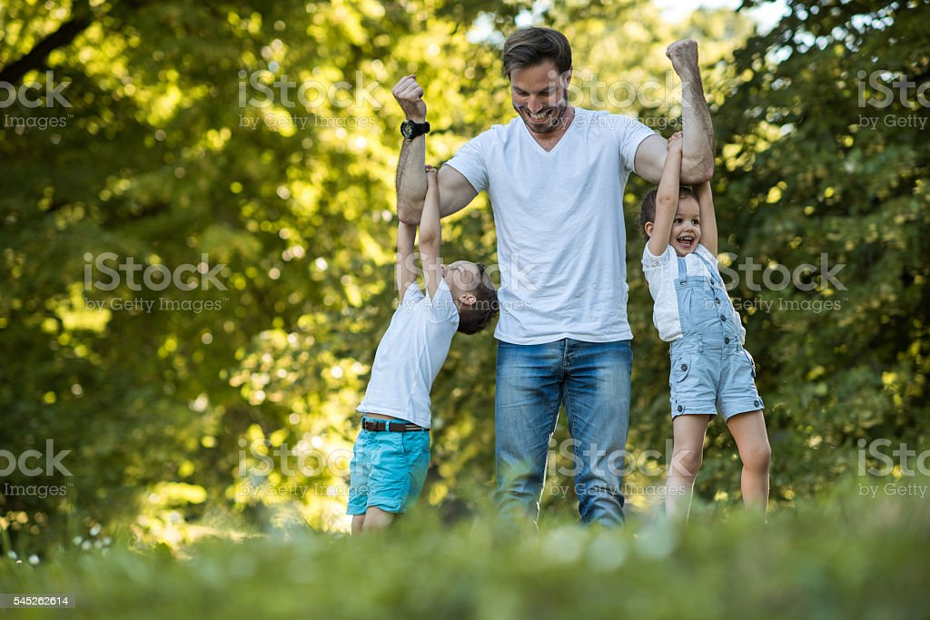 Our daddy is so strong! stock photo