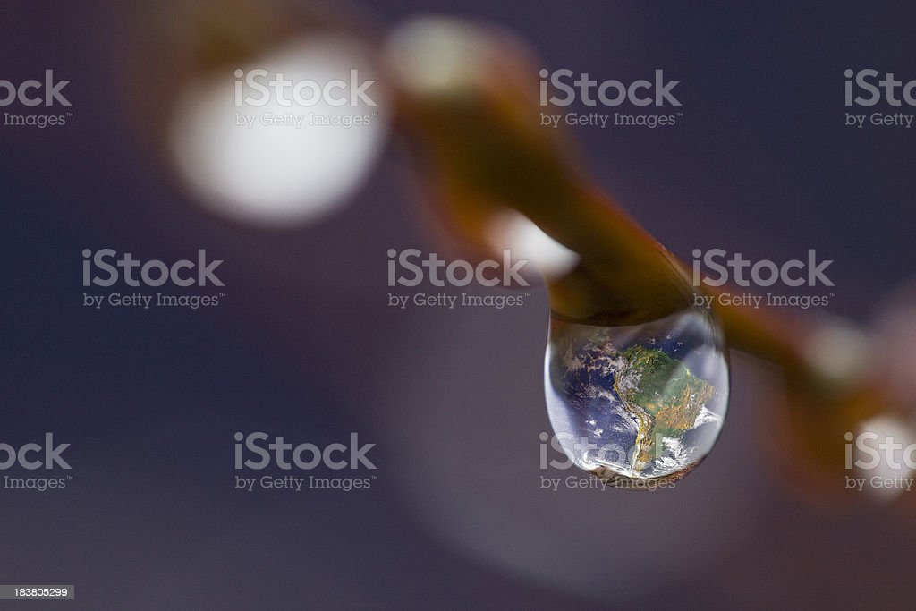 Our Earth seen in a drop of dew stock photo