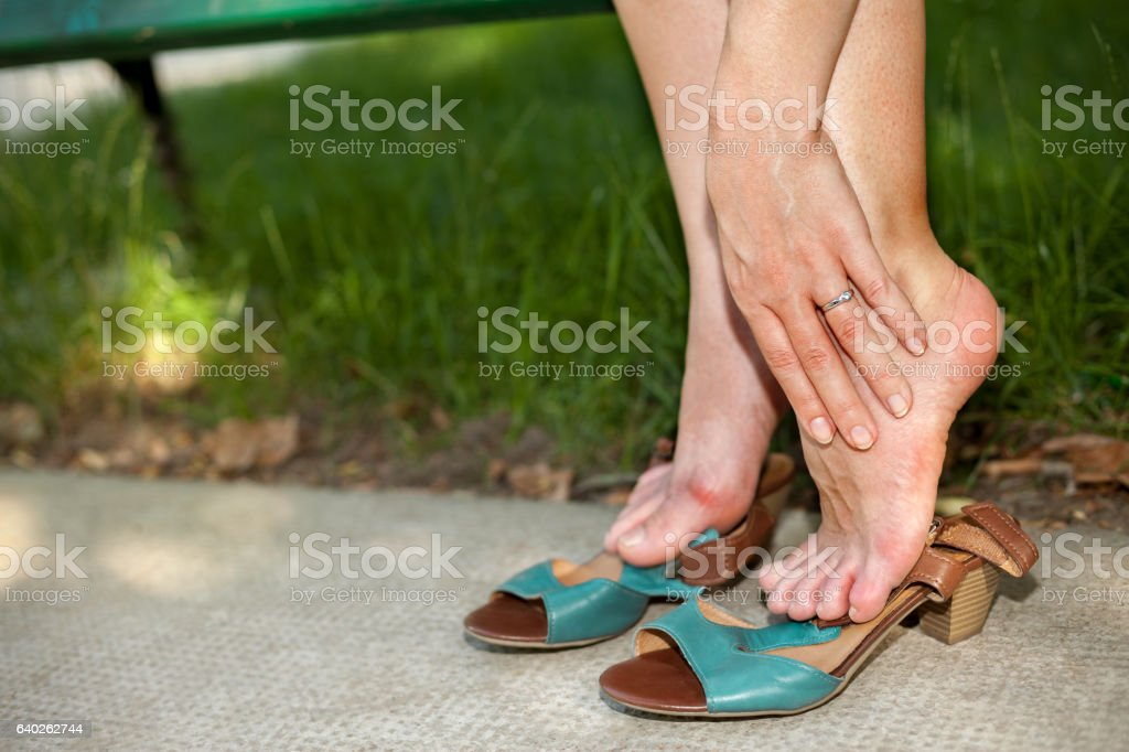 Our feet suffer stock photo