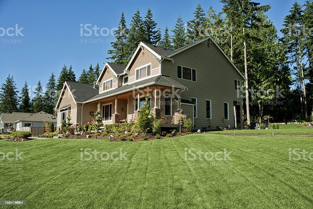 Our home with beautiful new grass stock photo