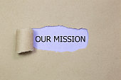 Our Mission message written under torn Brown paper