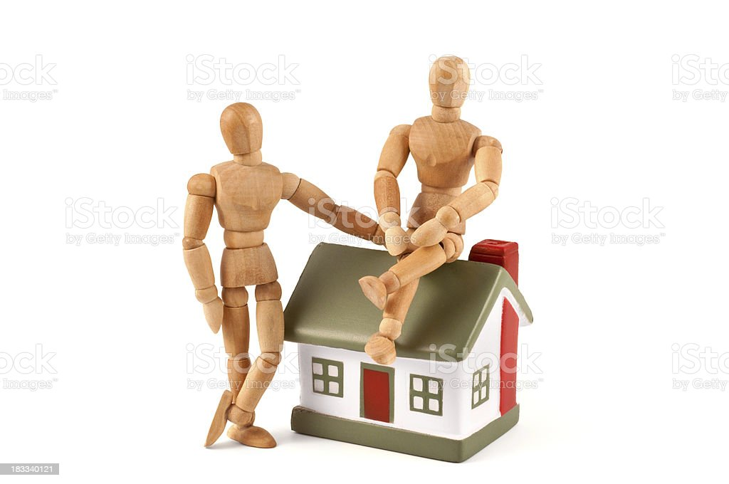 our new house - wooden mannequin with their home stock photo