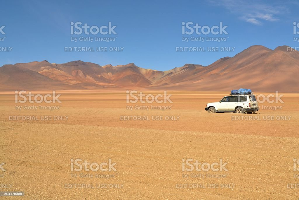 ourist jeep in Dali desert of Southwestern Bolivia near Uyuni stock photo