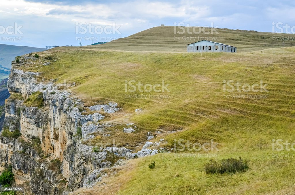 Нouse on the hill in the valley in autumn stock photo