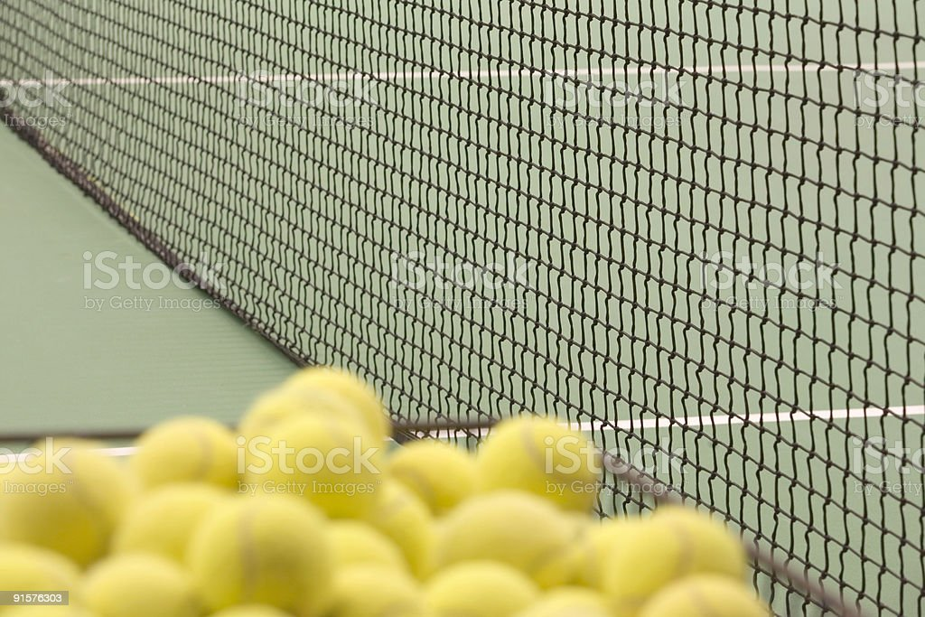 out of focus balls on an indoor tennis court royalty-free stock photo