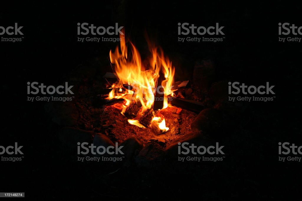 Out of focus camp fire, ringed by rocks royalty-free stock photo