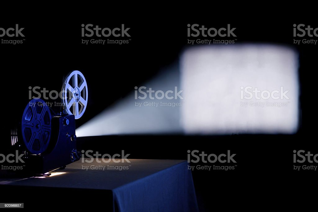 Out of focus film projection in a dark room stock photo