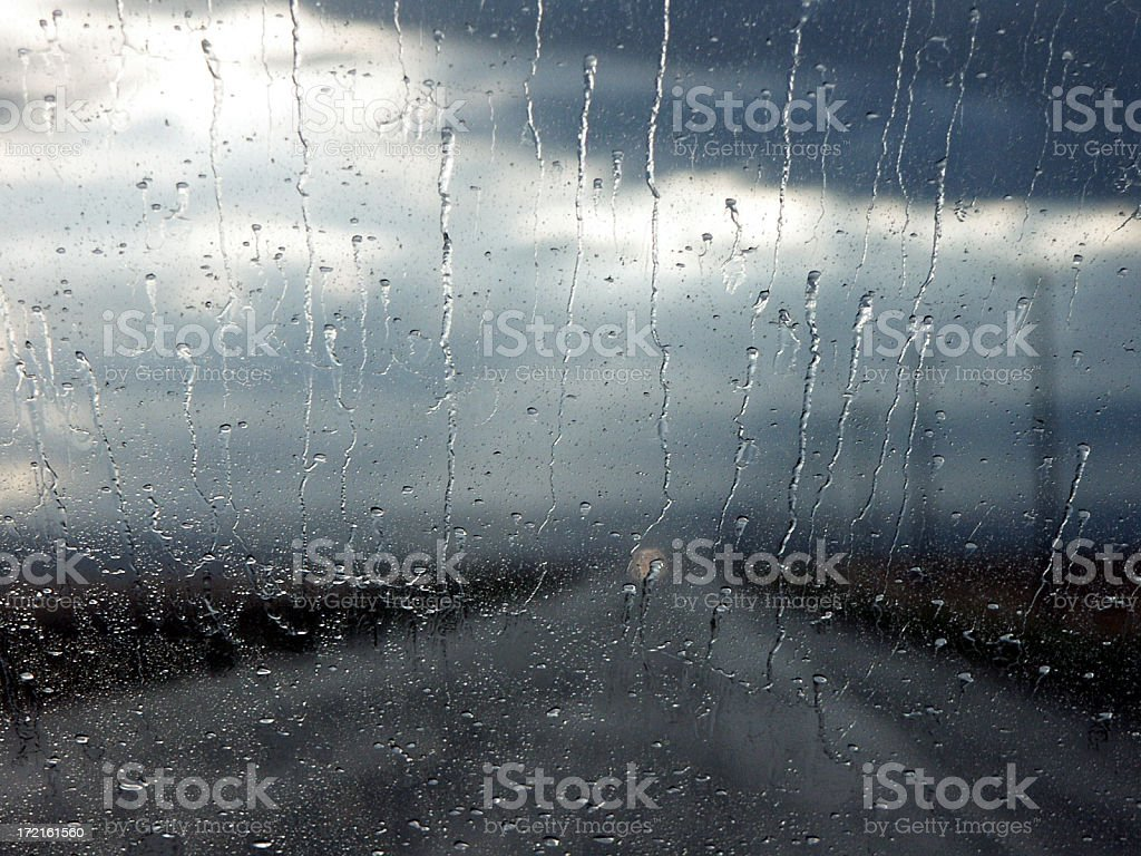 Out of focus rainy landscape viewed through wet window stock photo