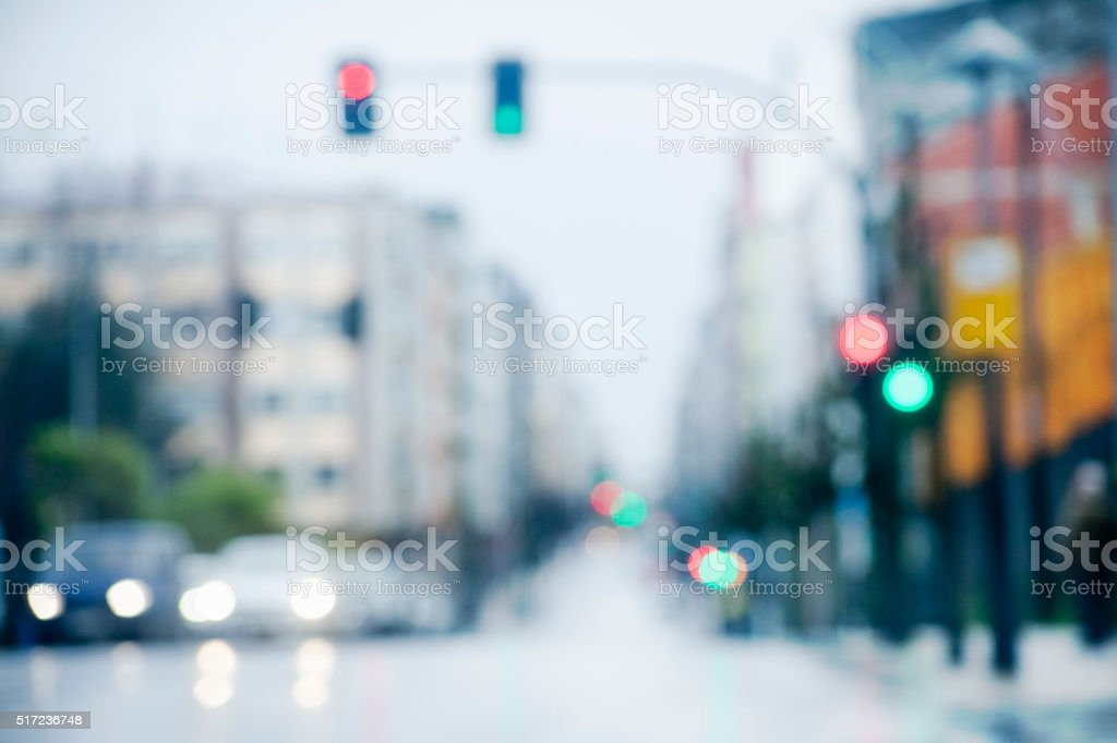 Out of focus rainy street view, colorful traffic lights. stock photo