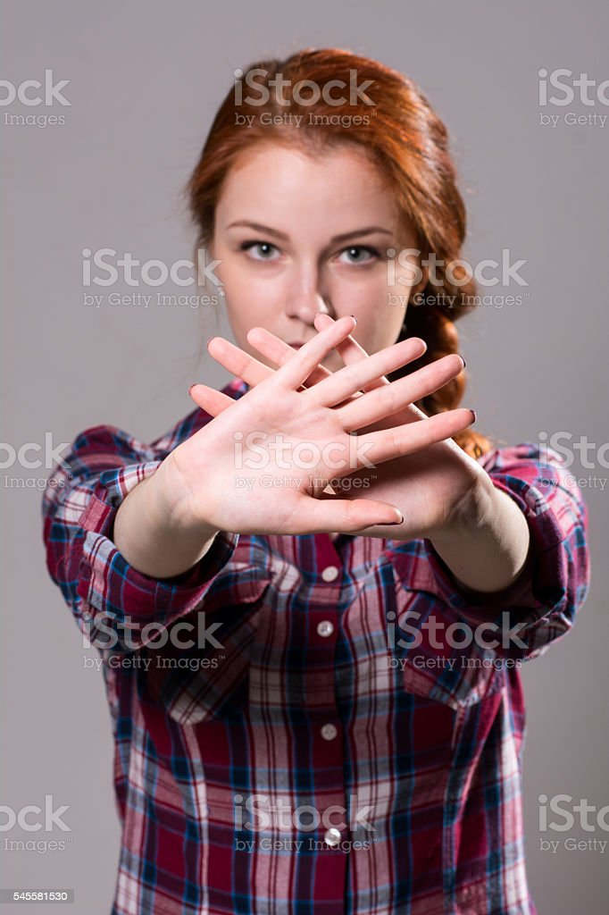 Out of focus woman with her hands signaling to stop stock photo