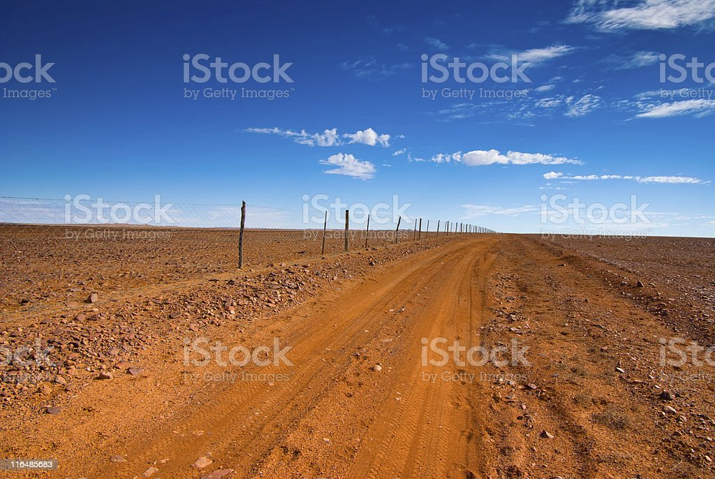 Outback Dirt Track along Dog Fence, Coober Pedy, South Australia stock photo