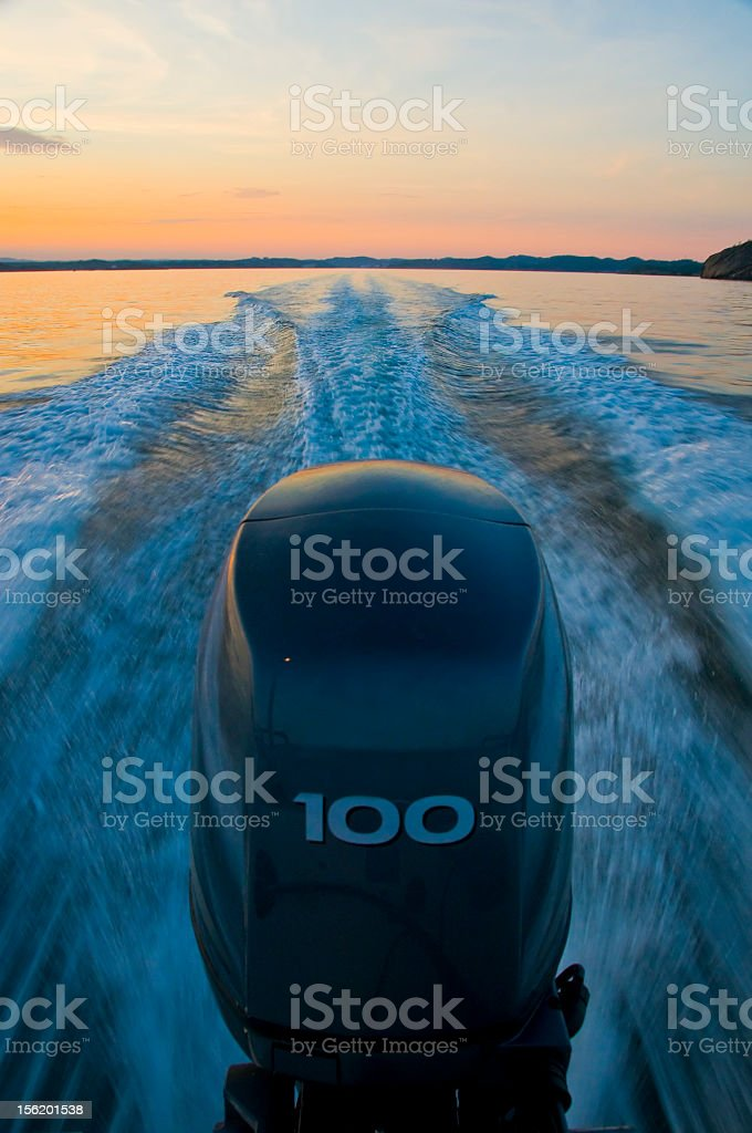 Outboard engine and wake royalty-free stock photo