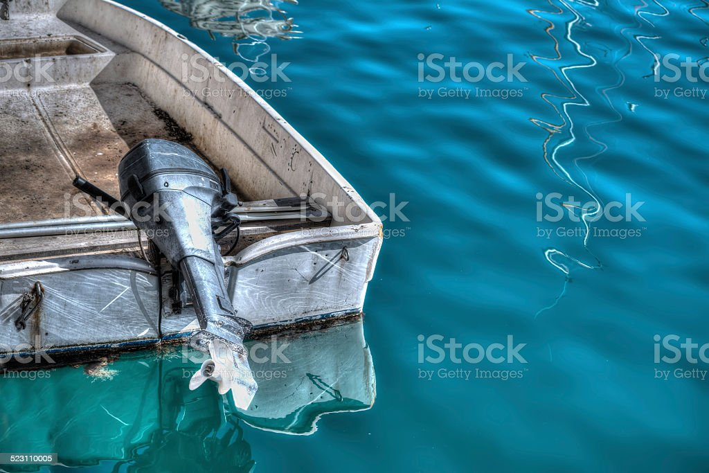 outboard engine on an old boat in hdr stock photo