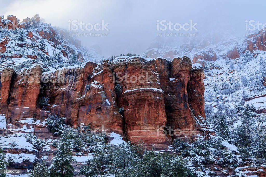Outcrop of Sedona, Arizona's red sandstone  during a winter storm stock photo