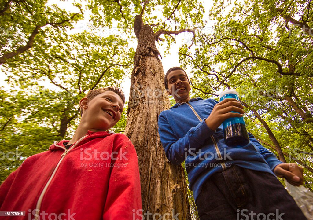 Outdoor adventure buddies giggling stock photo
