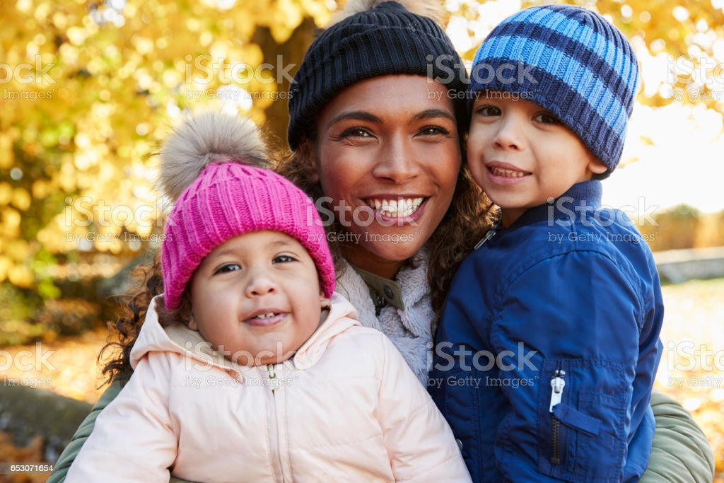 Outdoor Autumn Portrait Of Mother With Children stock photo