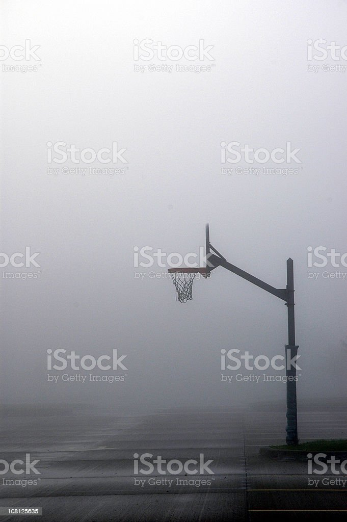 Outdoor Basketball Hoop in the Mist royalty-free stock photo