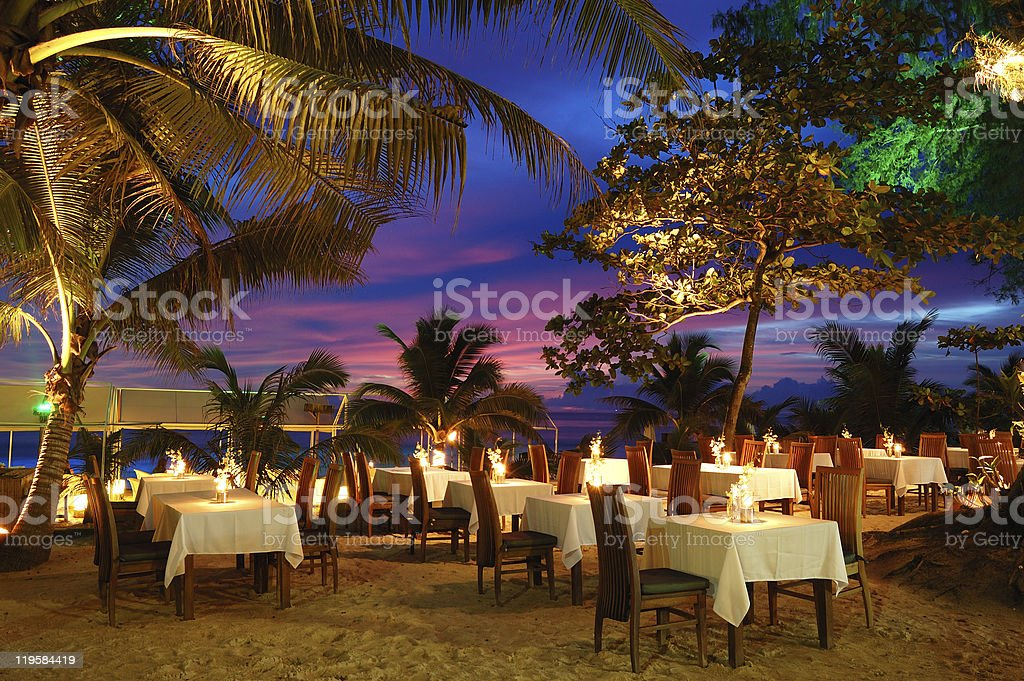 Outdoor beach restaurant during sunset in Phuket, Thailand stock photo