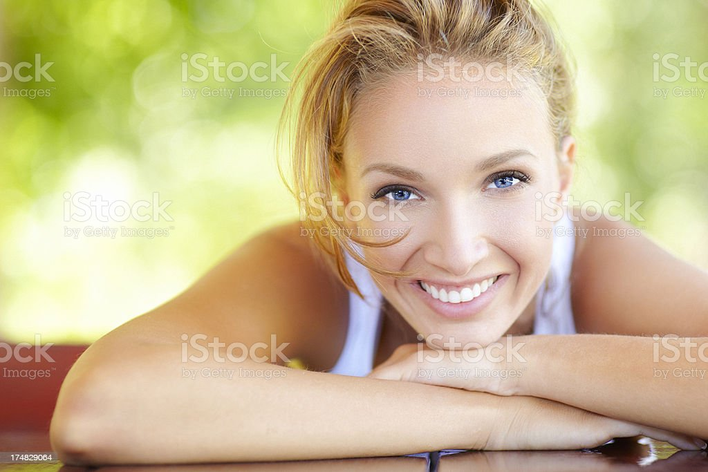 Outdoor beauty portrait of a young woman with beautiful smile stock photo