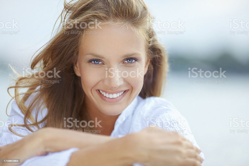 Outdoor beauty portrait of casual young woman with beautiful smile stock photo