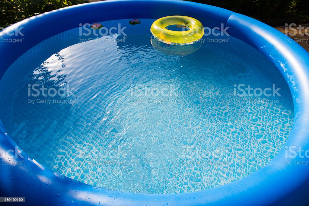 Outdoor blue inflatable pool with water stock photo
