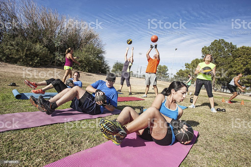 Outdoor Bootcamp Fitness Class stock photo