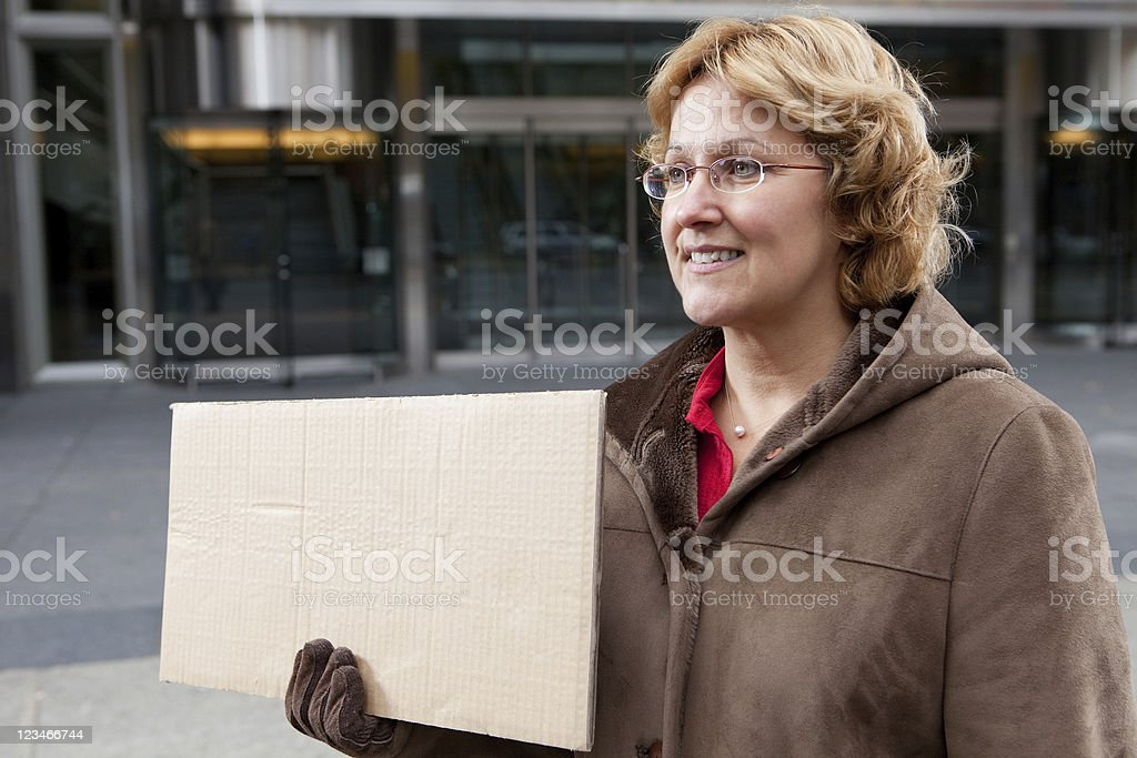 Outdoor business woman with blank sign stock photo