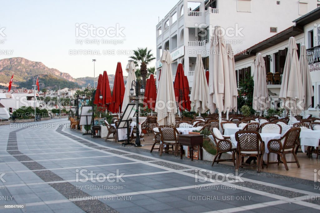 Outdoor cafe and restaurant of Marmaris with mountains on stock photo