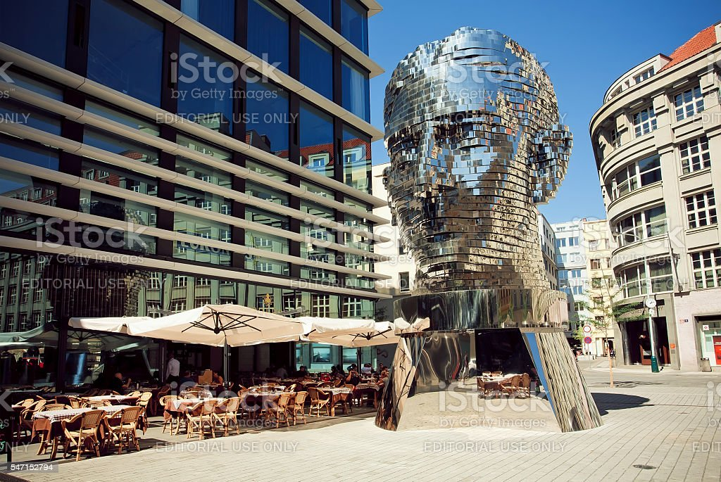 Outdoor cafe near famous artist David Cerny's sculpture Metalmorphosis stock photo
