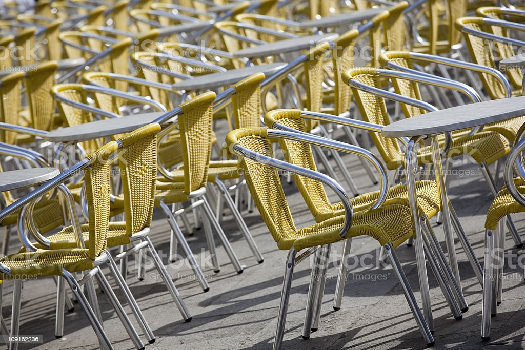 Outdoor cafe tables and chairs, Piazza San Marco, Venice Italy royalty-free stock photo