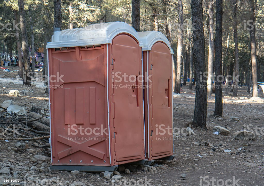 outdoor chemical toilet in the park stock photo