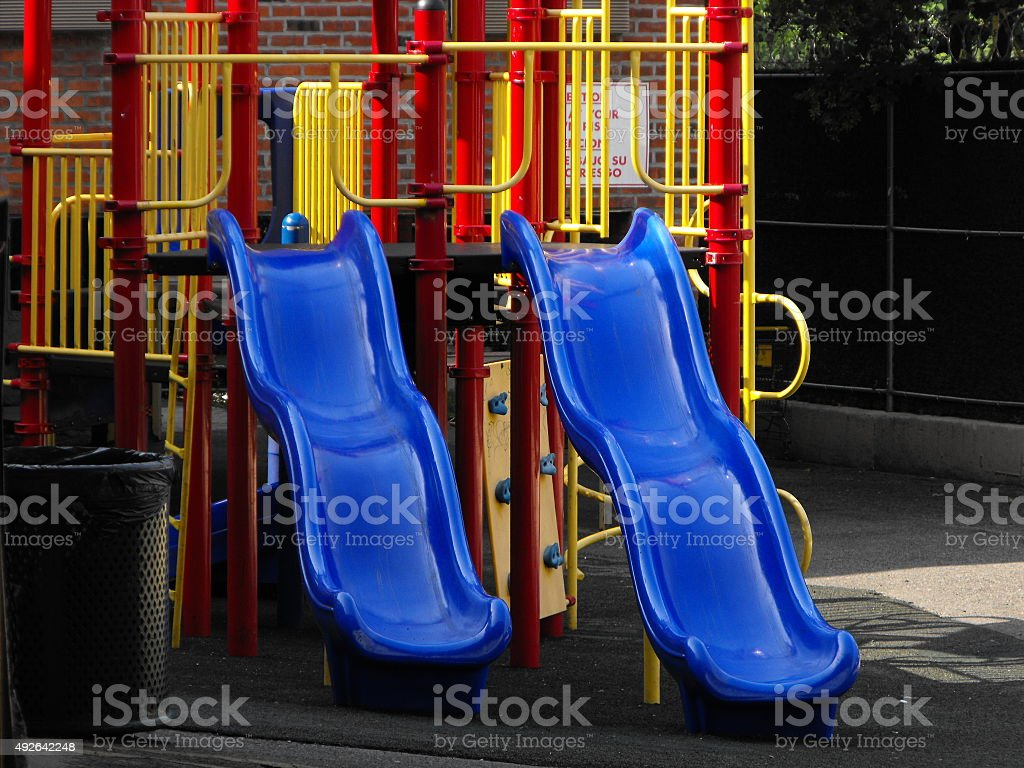 Outdoor Children's Playset with 2 Slides stock photo