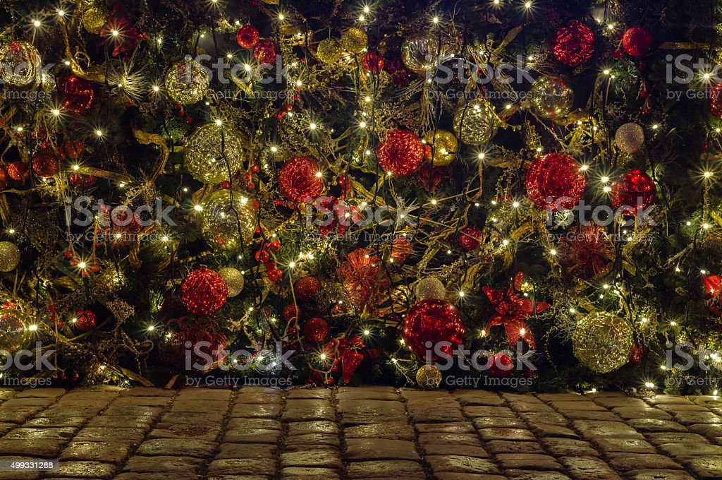 Outdoor Christmas and New year decoration on cobblestone ground stock photo