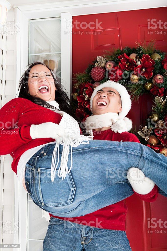 Outdoor christmas asian couple portrait stock photo