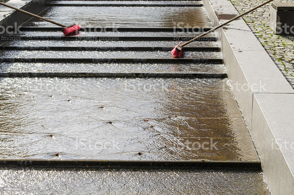 Outdoor cleaning with broom stock photo