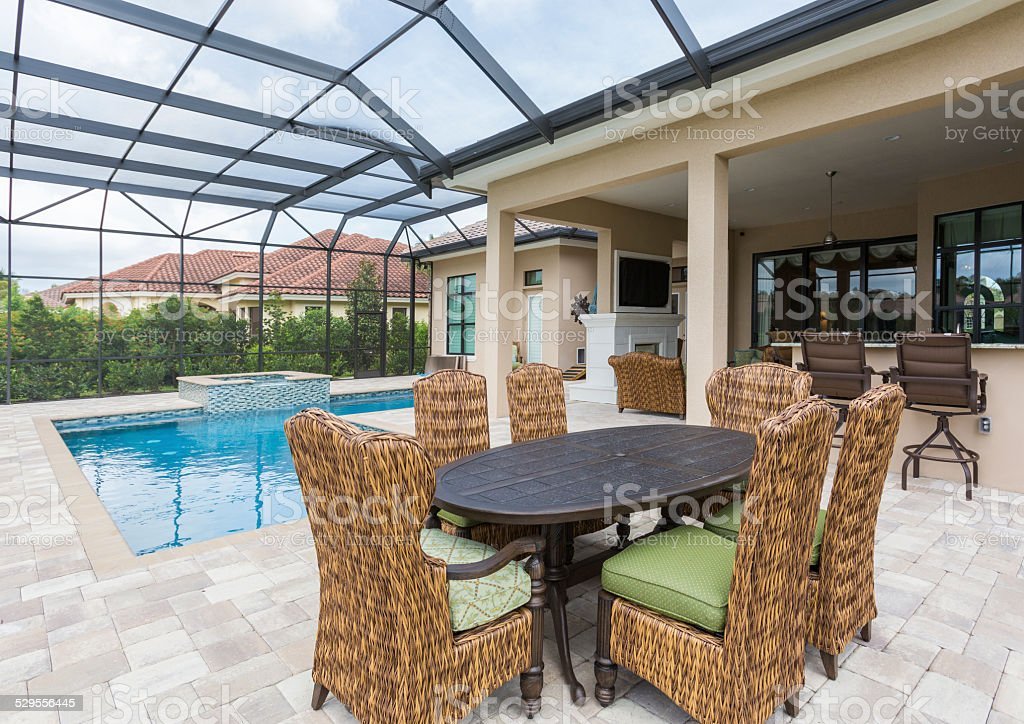 Outdoor Dining and Swimming Pool stock photo